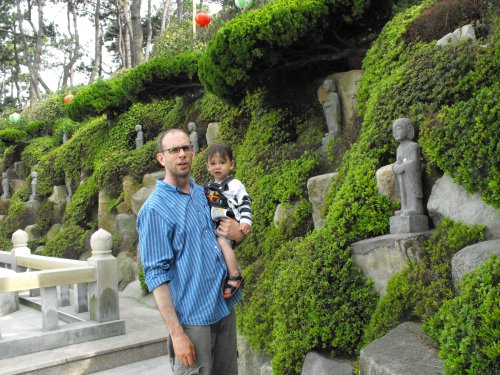 My little guy and I check out all the little Buddhas.